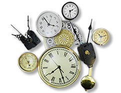 Various clock inserts, hands and other asorted clock parts.